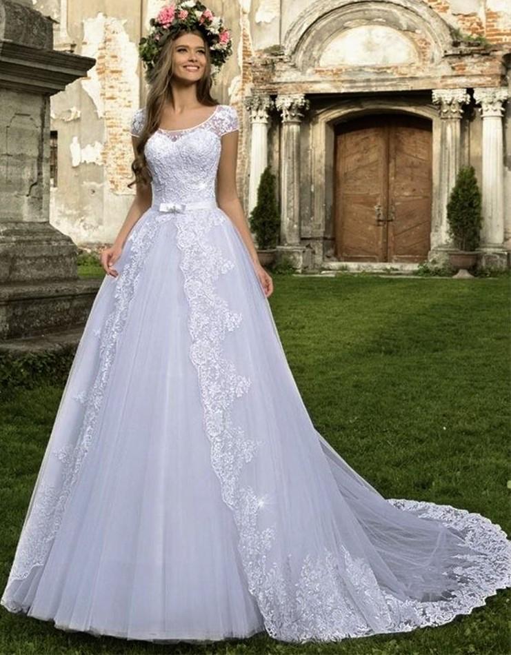 vestido de noiva com apliques e encaixe